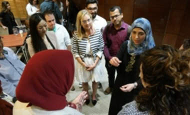 Hanan Al Hroub (second from right) speaks with students from the Harvard Kennedy School and Graduate School of Education during her visit to Harvard, September 22, 2016.