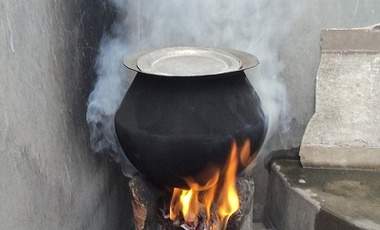 A rural stove using biomass cakes, fuelwood and trash as cooking fuel... It is a major source of air pollution in India, and produces smoke and numerous indoor air pollutants at concentrations 5 times higher than coal.