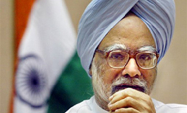 Indian Prime Minister Manmohan Singh gestures during his first press conference in New Delhi, India, Saturday, Sept. 4, 2004.