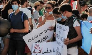 Youth demonstrators call for an end to the current garbage crisis outside the government offices in downtown Beirut, Lebanon on July 25, 2015.