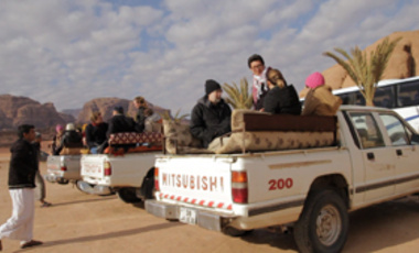 Students take a break from meetings for an excursion to Petra and Wadi Rum desert in Jordan.