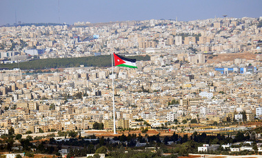 The Jordanian flag flies over Amman, the capital of the Hashemite Kingdom of Jordan, on Oct. 30, 2009.