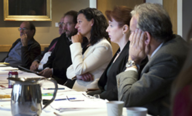 Juliette Kayyem  (center) considers a question following her presentation on counterterrorism at a Belfer Center Board of Directors lunction on counteh.