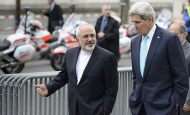 U.S. Secretary of State John Kerry speaks with Iranian Foreign Minister Mohammad Javad Zarif.
