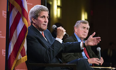 Secretary of State Kerry speaking to Harvard students during Belfer Center event hosted by Director Graham Allison (right).