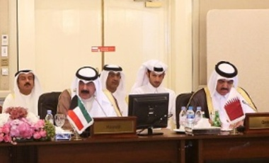 Kuwaiti foreign ministry undersecretary Khaled al-Jarallah (C) and Qatari foreign minister assistant Mohamed bin Abdullah al-Rumaihi (R) attend a meeting in Kuwait City aimed at tackling online recruitment of foreign fighters operating in Iraq and Syria.