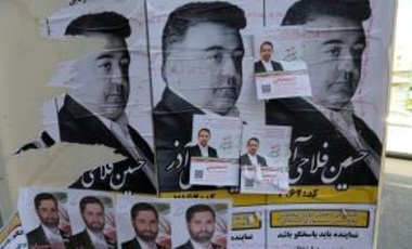 A picture taken on February 21, 2016 in a southern district of Tehran shows campaign posters of candidates running for the upcoming parliamentary elections in Iran.