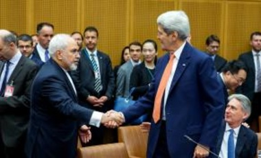 Foreign Minister of Iran, Mohammad Javad Zarif shakes hands with US Secretary of State John Kerry at the last working session of E 3+3 negotiations on July 14, 2015 in Vienna, Austria.