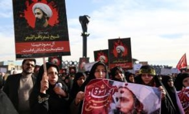 Demonstrators hold posters of Nimr Baqir al-Nimr during a protest rally against the execution of prominent Saudi Shia cleric Nimr Baqir al-Nimr by Saudi authorities, in Tehran, Iran on January 4, 2016.