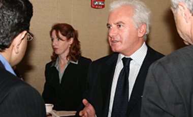 "Leonardo Maugeri discusses findings from his study ""Oil: The Next Revolution"" at a New York City Harvard Club event. The Belfer Center's Meghan O'Sullivan (center) participated in the discussion."