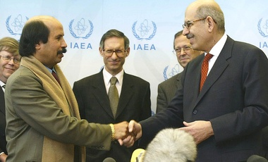 Libya's Science and Research Minister Matouq Mohamed Matouq and IAEA's Director General Mohamed ElBaradei, from left, shake hands after signing an agreement opening up Libya's nuclear activities to IAEA's perusal, March 2004, Vienna.