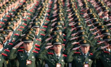Chinese soldiers salute during a ceremony in Hangzhou city, east Chinas Zhejiang province, November 15, 2013.