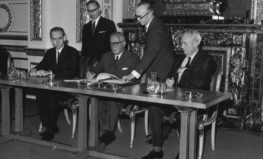 Britain's Foreign Secretary Michael Stewart signs the treaty on the Non-Proliferation of Nuclear Weapons at Lancaster House, London, watched by the Soviet Ambassador (left) and the US Ambassador (right). July 1, 1968.