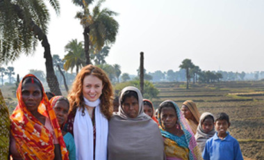 Alicia Harley with women and children in India's state of Bihar.