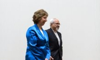 EU High Representative for Foreign Affairs Catherine Ashton, left, walks next to Iranian Foreign Minister Mohammad Javad Zarif, right, during a photo opportunity prior to the start of two days of closed-door nuclear talks Tuesday, October 15, 2013, at the