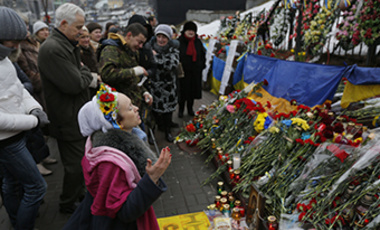 "People pay their respects to the ""Heavenly Hundred"" (those who died during 2013-14 protests) on Independence Square in Kiev, Ukraine, Friday, Feb. 20, 2015."