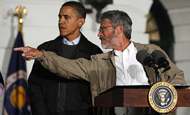 President Barack Obama gets direction from his science advisor John P. Holdren during an event on the South Lawn of the White House to explore the stars with middle school students.