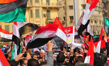 At a demonstration in Tahrir Square in Cairo, the flags of Egypt, Libya, and Tunisia were waved by the crowd