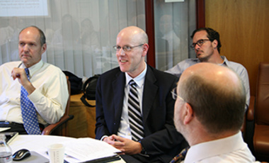 "Robert Reardon presents on ""Containing Iran"" at an International Security Program seminar. Also at the table: Stephen Walt (left) and Steven Miller."