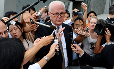 The U.S. Special Envoy on North Korea Stephen Bosworth is surrounded by reporters after holding the first meeting with North Korean Vice Minister Kim Kyu Gwan in New York on July 28, 2011.