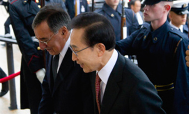 Defense Secretary Leon Panetta escorts South Korean President Lee Myung-bak into the Pentagon, Oct. 12, 2011.