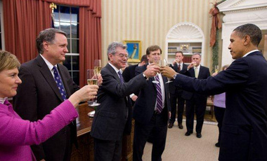 President Obama raises a toast to Gary Samore and his team in the Oval Office following Senate ratification of the New START Treaty on December 22, 2010.