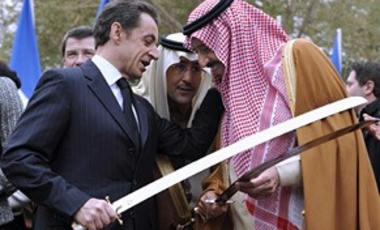 French President Nicolas Sarkozy, left, and Saudi Prince Salman Bin Abdelaziz al Saud, brother of King Abdullah, joke together as they hold swords, during a Saudi traditional war dance, Jan. 14, 2008 at the Royal Palace in Riyadh.