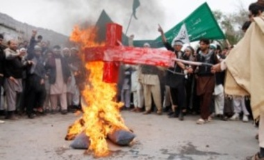 Afghans burn an effigy depicting U.S. President Barack Obama following the Mar. 11 killing of civilians in Panjwai, Kandahar by a U.S. soldier during a protest in Jalalabad, Afghanistan, Mar. 13, 2012.