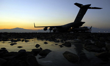 A C-17 Globemaster III at Baghram Air Base gets loaded for a Joint Precision Airdrop Delivery System of 40 bundles of humanitarian supplies to a drop zone in Afghanistan, on Jan., 14, 2008.