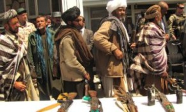 GHŌR, Afghanistan: May 28, 2012, Former Taliban fighters line up to handover their rifles to the government of the Islamic Republic of Afghanistan during a reintegration ceremony at the provincial governor's compound.