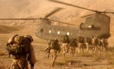 Soldiers quickly march to the ramp of the CH-47 Chinook helicopter that will return them to Kandahar Army Air Field on Sept. 4, 2003. The Soldiers were searching in Daychopan district, Afghanistan, for Taliban fighters and illegal weapons caches.