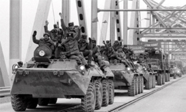 Soviet Army soldiers wave as their last detachment crosses a bridge on the border between Afghanistan and then Soviet Uzbekistan near the Uzbek town of Termez in this Feb. 15, 1989, file photo, as they leave Afghanistan after waging a 10-year war.