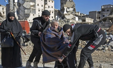 An elderly Syrian man is evacuated from a rebel-held neighborhood in Aleppo.