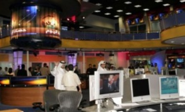 Representatives of media tour Al Jazeera's new news room on in Doha, Qatar, June 15, 2005. Its broadcasts have decimated state-run TV stations across much of the Arab world, leading some states to close its bureaus down.