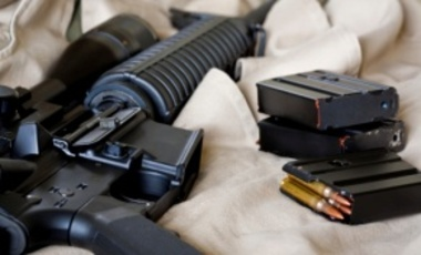 Close-up of AR-15 assault rifle and magazines with ammunition