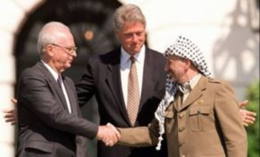 Israeli PM Yitzhak Rabin with President Bill Clinton & Yasser Arafat during the signing of the Oslo I Accord in 1993. The failing of this peace process was an important missed opportunity during Clinton's tenure.