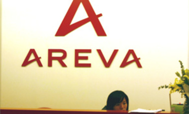 A Chinese staffer is seen at the head office of Areva China in Shanghai, Nov. 5, 2010. French nuclear reactor maker Areva signed a $3 billion deal with China Guangdong Nuclear Power Corp to supply 20,000 tonnes of uranium over 10 years,