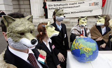 "Activists of the anti globalization organization attac are dressed like wolves in sheep furs while protesting against the upcoming world financial summit with a poster ""Wearing a sheep fur still does not change the system"" in Vienna on Nov. 14,  2008."