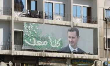 Propaganda poster of Syrian President Bashar al-Assad. The Syria deal—Assad gives up his CW, but stays in power—has the potential of resurrecting this fundamental quid pro quo principle that enables coercive diplomacy to work.