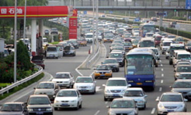 Masses of cars are seen on a road in Beijing, China, July 17, 2008. As many as 5.5 million cars will be on Beijing city roads by 2015.