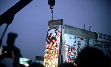 Blocks of the 'Berlin Wall' being torn off by cranes. The wall was torn down by rejoicing Berliners when the border separating East and West Germany was officially opened on Nov. 9, 1989, thus symbolising the end of the 'cold war.'