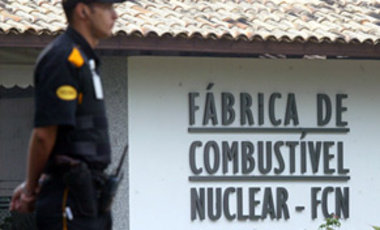 A security guard stands beside the entrance of the nuclear facility, FCN, Combustible Nuclear Factory in Resende, about 100 kilometers northwest of Rio de Janeiro, Brazil, on Oct. 19, 2004.