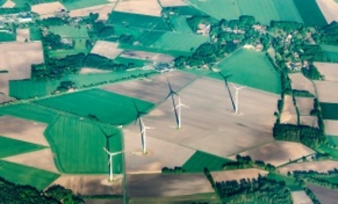 Aerial view of rural landscape near Bremen, Germany, with wind generator.