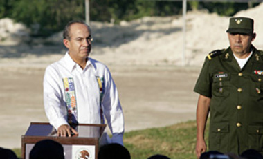 Mexico's President Felipe Calderon presses the button to start a wind turbine that is planned to help power the United Nations Climate Change Conference in Cancun, Mexico, Nov. 28, 2010.
