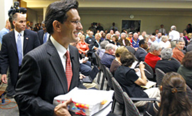 U.S. Rep. Eric Cantor, R-7th, carries a copy of the House health care bill inside the <em>Richmond Times-Dispatch</em> in Richmond, Va. on Sep. 21, 2009 before the Public Square on health care reform, sponsored by the newspaper.
