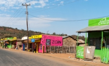 Aug. 31, 2009: Buildings with advertising for cellular phone companies in rural Kenya. Safaricom, Ltd is a leading mobile network operator in Kenya, formed in 1997.