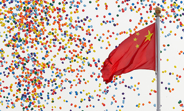 Balloons float past a Chinese flag on Tiananmen Square after being released during a parade commemorating the 70th anniversary of the founding of Communist China in Beijing, Tuesday, October 1, 2019.
