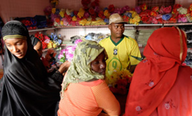 Young women shop for China-made plastic flowers in a store opened by Chinese businessmen in Bissau, Guinea-Bissau, Jan. 3, 2007. In Africa, China has found a huge market for its cheap goods and the natural resources it needs to sustain its growth.