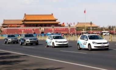 Volkswagens Golf electric cars and Touareg hybrid cars pass by Tiananmen Square in Beijing, China, 6 April 2011. Volkswagen China announced that the first demonstrative electric car motorcade of Volkswagen worldwide will be in Beijing.