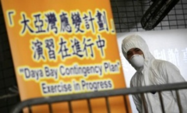 A staff member from the Food and Environmental Hygiene Dept. looks on during the Daya Bay nuclear power plant contingency plan exercise in Hong Kong, 27 April 2012.